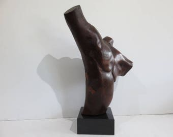 Mid-Century Modern Abstract Male Torso Sculpture, Carved From Lignum Vitae Wood On A Black Marble Base, In The Manner Of Bertram Eaton.