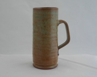 Very tall coffee mug in  green with brown streaks by Mike Edwards of Bolingey Pottery , Cornwall . 1960s studio pottery