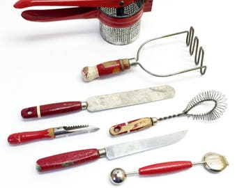 Set of 7 Retro Red Kitchen Utensil Tools; Peeler, Cake Knife, Potato Ricer, Masher, Apple Corer, Whisk, Mellon Baller Scoop Lemon Peel Shave