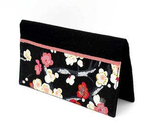 Checkbook cover made of black cotton with pink, white and red cherry blossoms