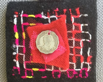 Textile brooch schedules and colored with a touch of Asia