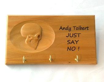 Personalized wood carving of a skull on a key holder