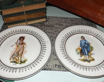 PAIR of mid-century (c. mid 1940s) Wood & Sons Pinkie Lawrence + Blue Boy portrait plates. Gold filigrée, scalloped gold edge.