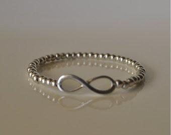 Bracelet infinite and balls small zamak
