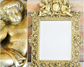 Ornate rococo style gold gilt bevelled edge wall mirror heavy plaster frame cherubs cupids putti thistles 1950s, gift idea