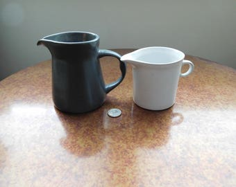 Two Bennington Pottery Creamers.  Cooperative Design.  One black and one white. Bennington Potters.  Vermont.
