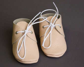Light pink baby moccasins with shoe laces. Newborn, infant, toddler shoes