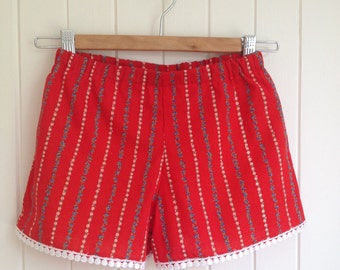 Girls Summer Shorts in cool red cotton with flower strips and bottom trim