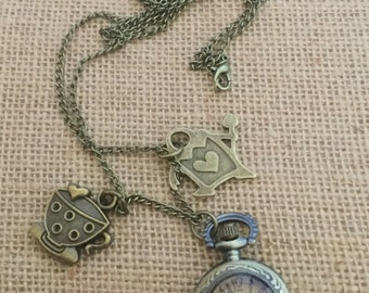 Alice in wonderland themed necklace watch