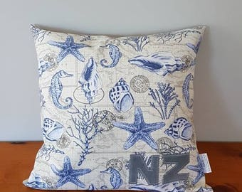 New Zealand Sea themed cushion cover with NZ letters.  Button back fastening.  18 x 18 inches.