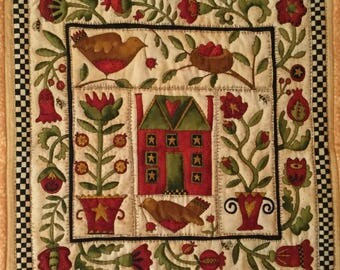 By Quilted birds and flowers