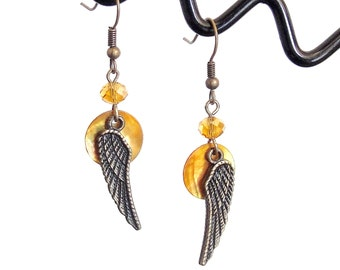 Bronze earrings with wing and topaz crystal pendant