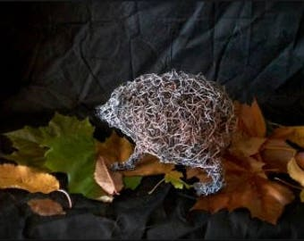 Handmade hedgehog sculpted from wire netting.