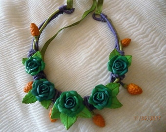 Blue roses with orange berries. Spring. Made by hand without molds.