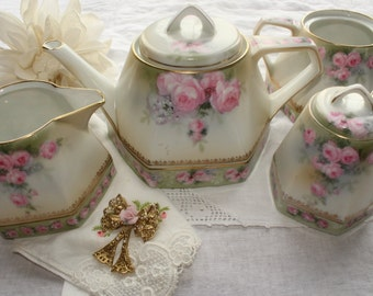 RS Germany: Antique hand painted tea set (teapot, creamer, sugar bowl, jam container)