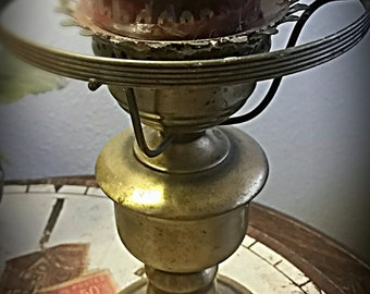 The look of brass in a vintage inspired candle stand .