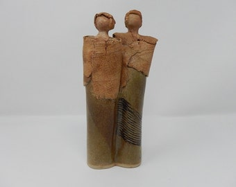 Sculpture in sandstone signed FM, character design
