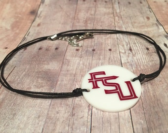 "Florida State University choker. FSU choker. Disc is 1.5""."