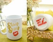 Stay Sexy. Don't Get Murdered. Standard mug. My Favorite Murder Inspired.