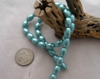11 mm x 8 mm Aqua Oat Pearl Beads  (1992)