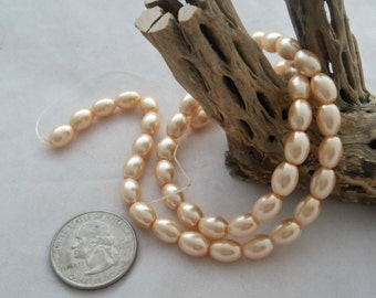 8 mm x 6 mm Light Peach Oat Pearl Beads  (1991)