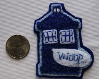 "Hand-sewn TARDIS pin, ""VWOOP"" noise bubble"
