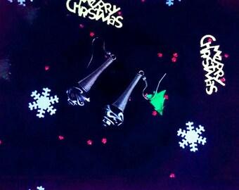 Black and white swirl earrings with long gun-metal cone beads