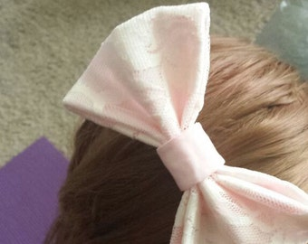 Pink Bow With Lace Overlay