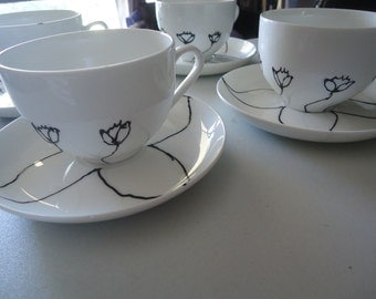 Hand-painted black and white tea cups, Set of 4.