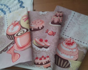 A set of wafer towels, a kitchen towel, a hand towel, a guest towel, napkins, a gift