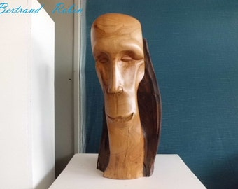 Cherry wood, human head sculpture: a smile.