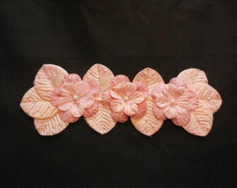 A peach pink beaded fabric floral motif / peach pink beaded floral applique is for sale. sold by per piece