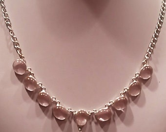 Silver necklace with crystal encrusted pink natural