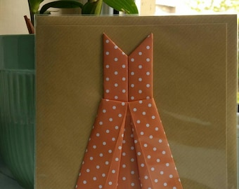 Greeting card with an Origami dress in polka dot print.