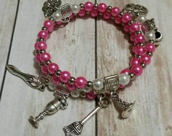 Beautiful pink and silver Witches ladder beaded memory wire wrap bracelet with seven pagan-themed charms/Wiccan /Pagan /New Age
