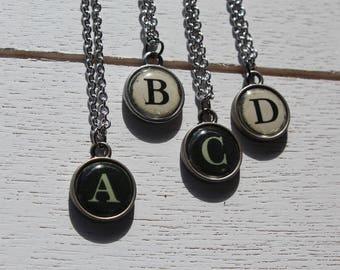 Typewriter key (style) letter necklace.