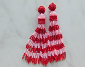Long earrings with red and pink stripes