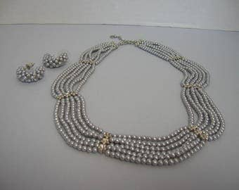 A multi- strand choker necklase with matching earrings