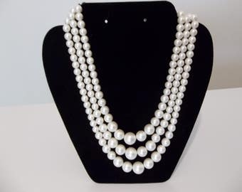 Antique pearl look triple strand necklace