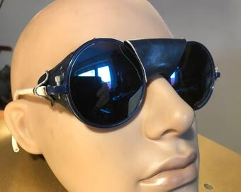 Vintage glacier sunglasses of 1970 dark blue metal frame and top grain leather equipment