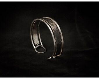 Unisex bracelet in silver inlaid copper law