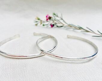 thin, silver cuff bracelet