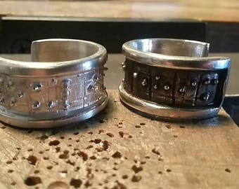 Silver braille rings for him and her