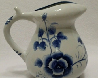 Beautiful ceramic blue and white floral pitcher