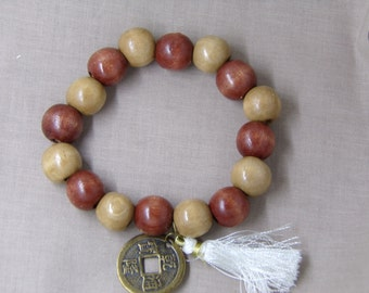 N1262 Brown Wooden Handmade Bracelet with With Chinese good luck coin and Tassel.