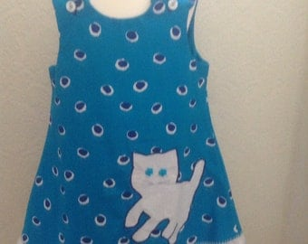 Girls Blue pinafore with cat appliqué.