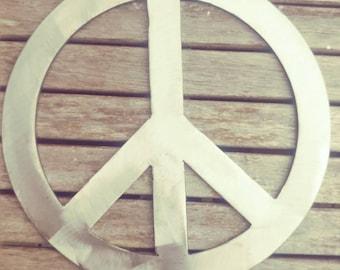 Rustic bohemian hippie metal peace sign retro.