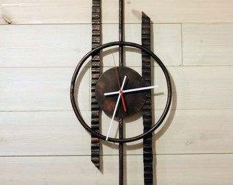 Hand forged wrought iron wall clocks