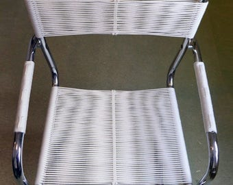 Modern cantilever chair with woven white seating, Marcel Breuer Interpretation