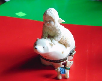 POLAR EXPRESS by Dept 56 Snow Baby riding a Polar Bear trinket boa